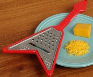 Shred into a block of cheese with this rockin' Guitar Cheese Grater