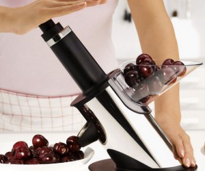 Pits cherries as fast as you can pump your arm!