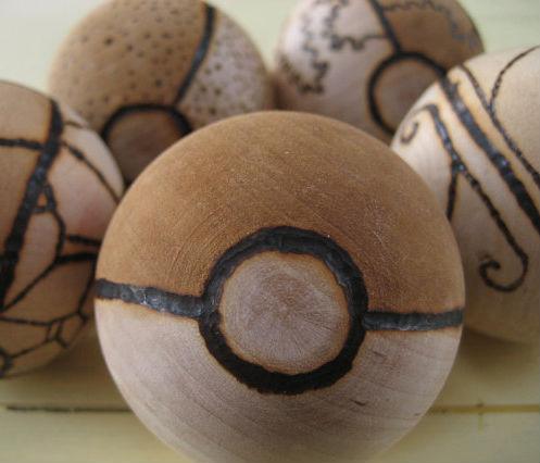 custom wood burned pokeballs
