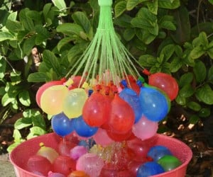 A hose attachment that fills up 148 water balloons in under a minute… Where was this when I was a kid?!