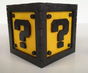 This metallic black light box features the question block from Super Mario Bros. on all four sides. Please don't hit it though – money won't fall out!