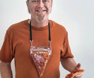 The Pizza Pouch isa bold (and delicious) fashion statement. Portable pizza. The best invention since delivery.
