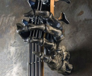 "Grim Reaper Skeleton Hand Guitar Holder also known as the ""Grip Reaper"" without actually ripping your beloved guitar."
