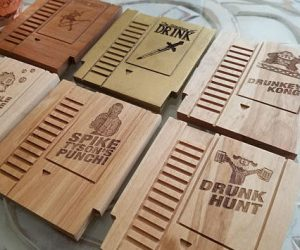 Wooden Gaming Coasters – These Solid Wood Coasters are made from a random mixture of Cherry, Alder, Pecan, Walnut, Maple, Cedar, and Beech wood. Graphics are laser engraved onto the