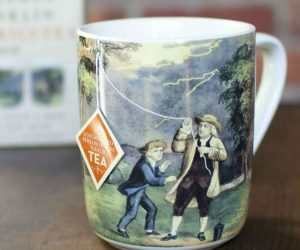 Ben Franklin Kite Tea Mug – The Benjamin Franklin Electrici-Tea mug celebrates the Founding Father's experiments with lightning, and features a Currier & Ives 1876 hand-colored lithograph of Ben and his