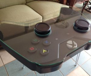Xbox Controller Coffee Table – Handmade coffee table inspired by the Xbox One gaming controller. Dimensions: 26″Depth, 39″Width, 26.5″ Height as shown in pics (leg height selected will depict overall height)