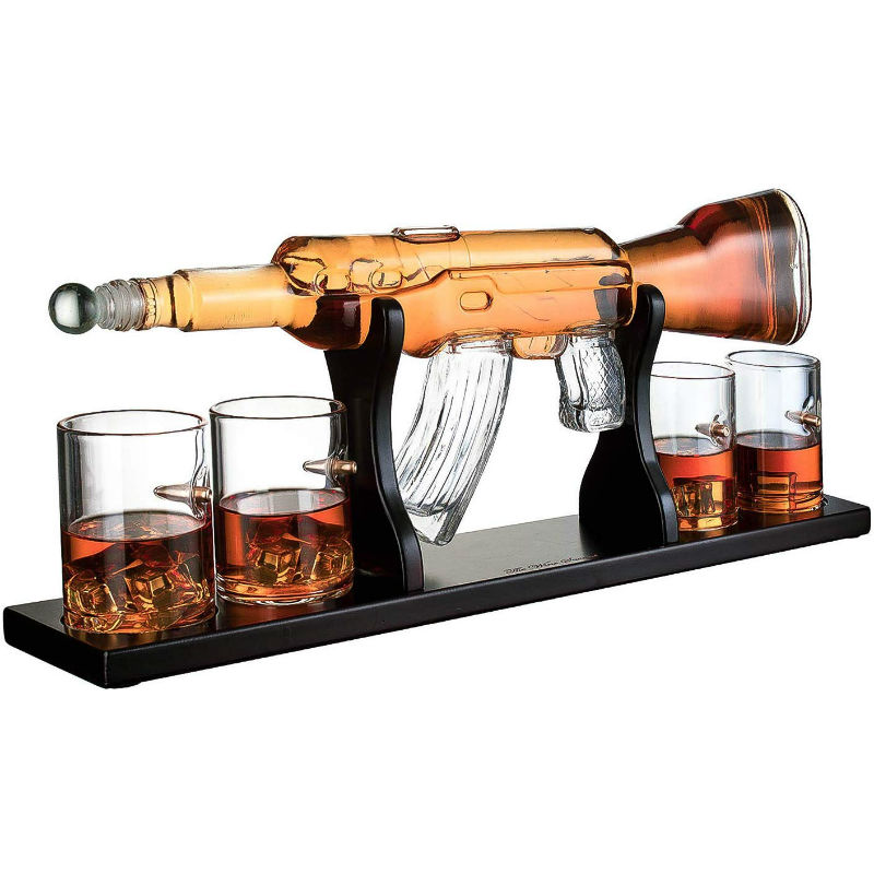 gun decanter with whiskey bullets
