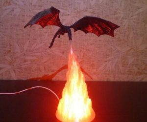 Fire Breathing Dragon Lamp – This handmade 3D printed fire breathing Dragon lamp features a remote control with 16 Color changing lights to choose from.