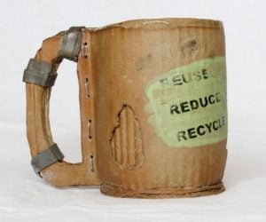 """Ceramic Cardboard Cup –Green glazed splatter with black printing of """"Reduce, Reuse, Recycle"""" and symbol."""