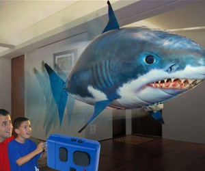 Take control of your very own shark with the Air Swimmer remote control shark! This toy can climb, descend, and use its tail for turning.