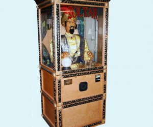 """Make a """"big"""" impression with this classic novelty arcade machine. Just feed it quarters and the animatronic fotune teller will give your fortune."""