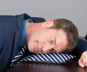 This inflatable pillow neck tie makes work time naps a breeze!