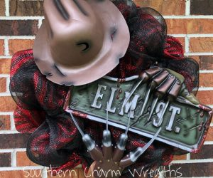 Freddy Krueger Halloween Wreath – 24″ (18″ frame, 24″ total) deco mesh wreath with hand made Elm Street sign, Freddy's hat, and glove.