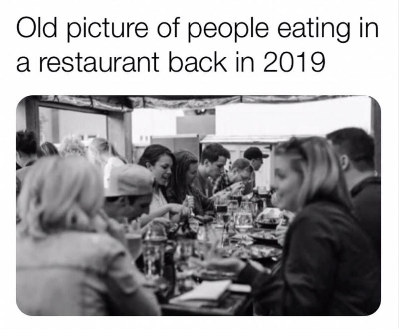 old picture of people eating at a restaurant back in 2019